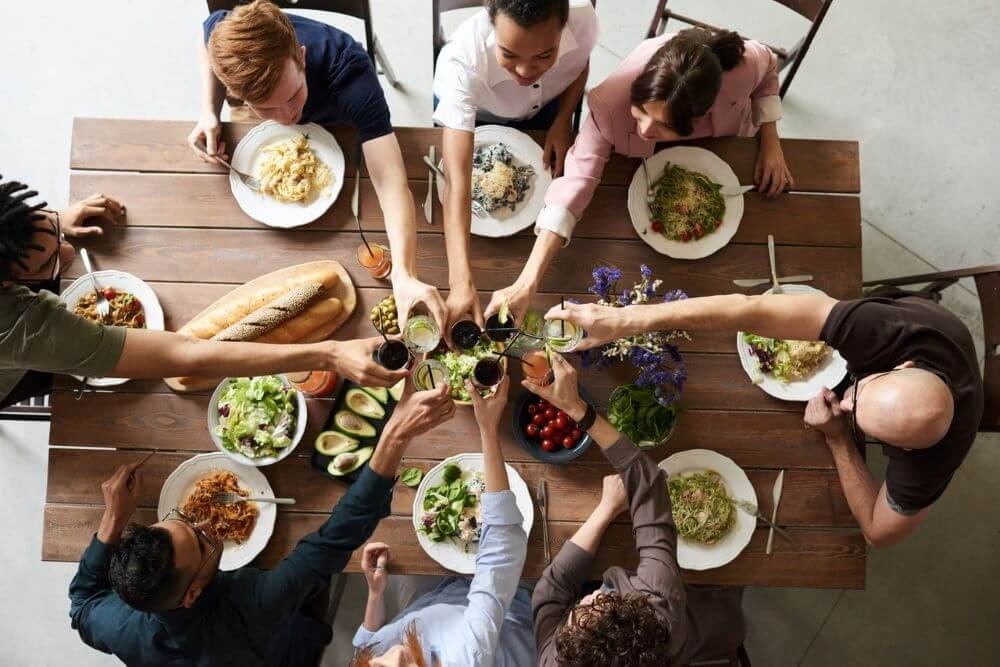 Sharing meals is a great way to build relationships and maintain mental health. Photo by Fauxels.