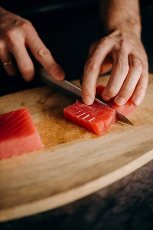 Slicing Sashimi Sushi. Photo by cottonbro.