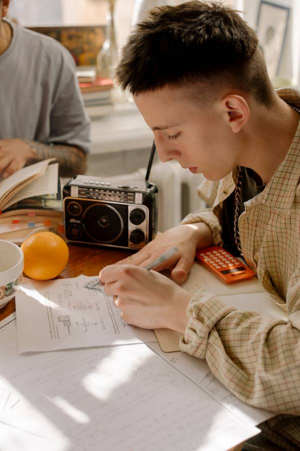 studying with Radio.  Photo by Cottonbro